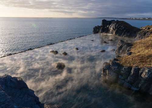 This new geothermal infinity lagoon in Iceland has dramatic ocean views