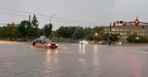 Floods turn downtown Salt Lake City into a 'river' as severe thunderstorms lash city