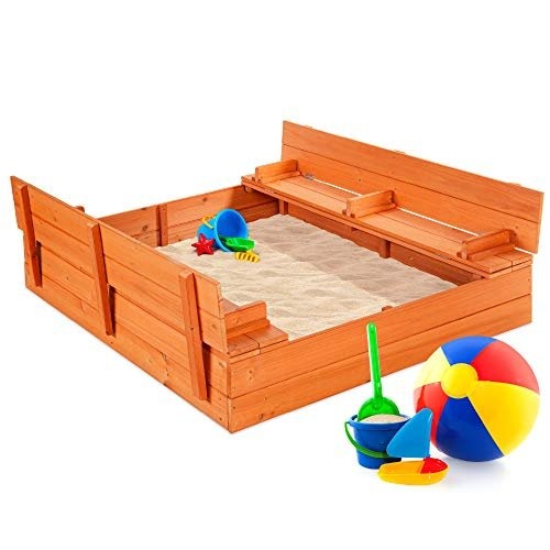 Large wooden sandbox with bench seating