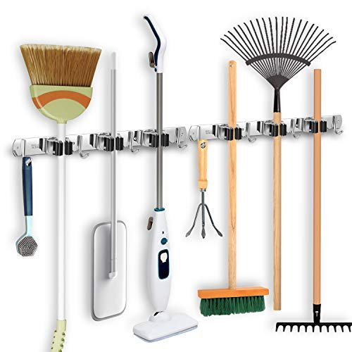 49% off a wall-mounted broom and mop holder