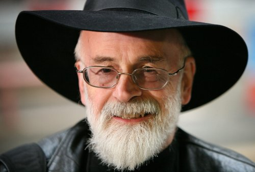 """Terry Pratchett's Daughter Dismisses """"Horrifying"""" Claims That Author Would Have Been a Transphobe"""