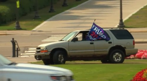 Woman in SUV with Trump Flag Drives Over Minnesota Capitol Lawn During Press Conference