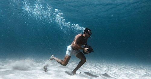 Veterans Don Tran and Kaj Larson Complete a Record-Setting Underwater Rock Run