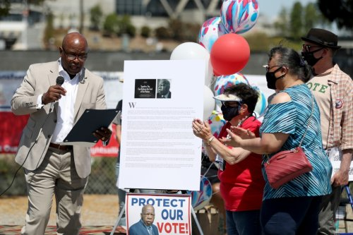 'Everyone needs to count': Oakland car caravan honors John Lewis, voting rights