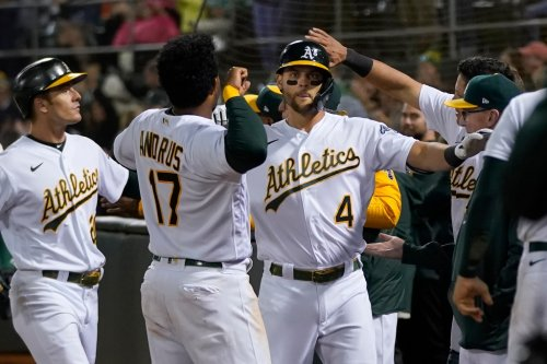 Behind Pinder's grand slam and a Montas gem, the Oakland A's beat rival Houston Astros