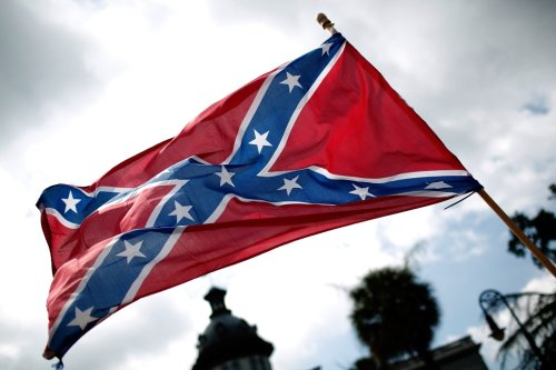 A giant Confederate flag went up in the Ozarks. One woman answered with a billboard