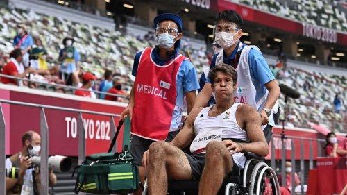 Olympia-Schock: Zehnkämpfer kehrt nach Krebs-Diagnose zurück - Jetzt wird er im Rollstuhl abtransportiert