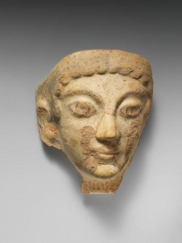Terracotta antefix (roof tile) with female head | Etruscan, Cerveteri | The Metropolitan Museum of Art