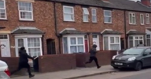 Screaming man with 'machete' filmed chasing people down quiet road