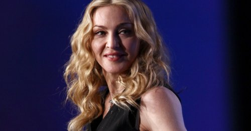 Madonna 'sits on a throne and gets fit guys to do her bidding' according to Alan Carr and who can blame her?