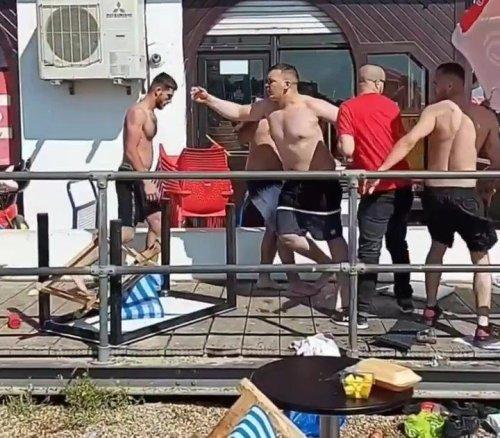 Huge fight breaks out on crowded beach as men start hurling deckchairs