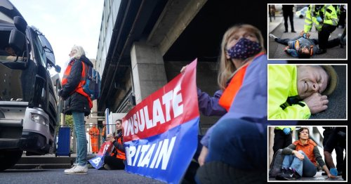 Insulate Britain protester winces in pain as he glues his face to road