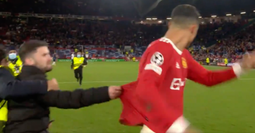 Pitch invader tackled to the ground after grabbing Manchester United hero Cristiano Ronaldo
