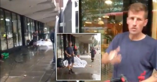Street cleaner filmed spraying jet washer at homeless person in makeshift bed