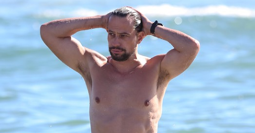 Ioan Gruffudd emerges from the sea James Bond style as a single man after messy break up