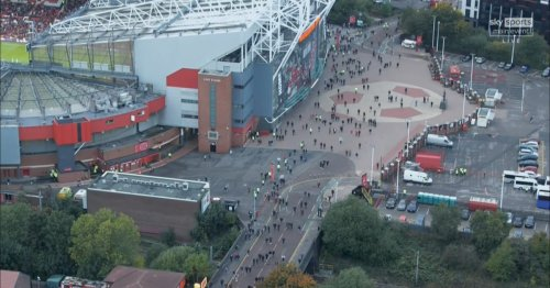 Manchester United fans leave Old Trafford at half time after Liverpool run riot