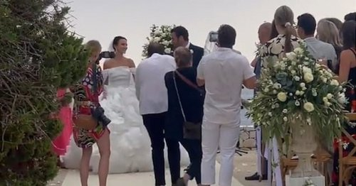 Made In Chelsea's Lucy Watson shares glimpse of extravagant wedding dress as she marries James Dunmore in Greece