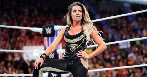 WWE legend Trish Stratus flashes toned abs and says she's 'always ready' after Sasha Banks challenge