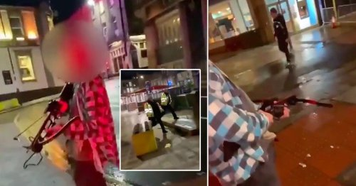Man carries crossbow into town centre and aims it at passersby