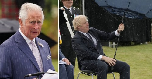 Boris Johnson prats around with umbrella at unveiling of fallen police memorial