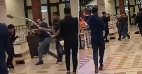 Mops used as weapons in bizarre brawl in shopping centre