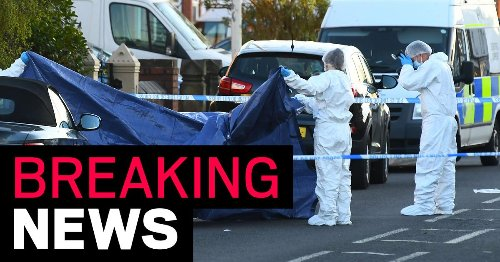 Two arrested on suspicion of murder after man's body found in street
