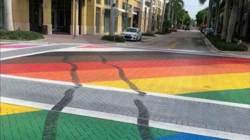 A driver defaced a Pride street mural during a Trump birthday rally. He turned himself in