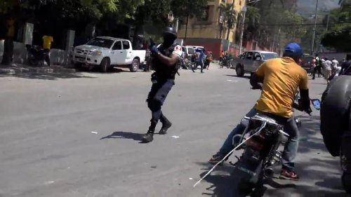 A 'Mass for the freedom of Haiti' turned violent, chaotic, with police firing tear gas