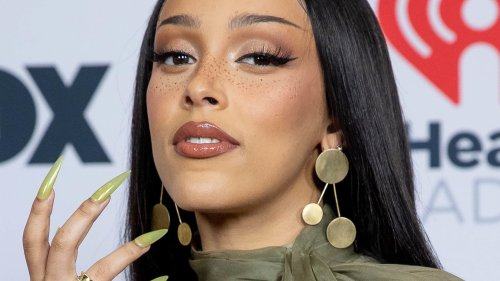 Doja Cat poses for some seriously risqué snaps to promote new album 'Planet Her'
