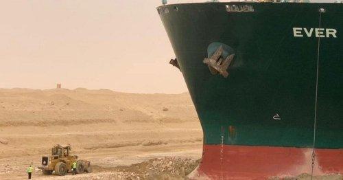 Captain of huge 224,000 tonne megaship stuck in Suez Canal blames 'strong winds'