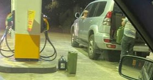 Angry lorry driver exposes man filling car with jerry cans amid fuel shortage