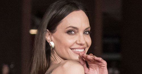 Angelina Jolie suffers wardrobe malfunction with crooked hair extensions