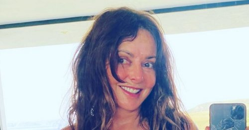 Carol Vorderman fans floored by her sizzling display in unzipped wetsuit