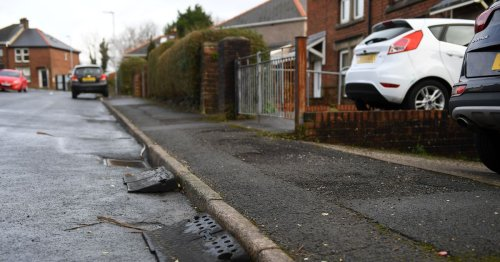 Angry families hit with £215 charge to drive across pavement to their own homes