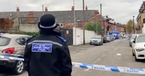 Two men shot with one fighting for life after gunman blasts them in the neck
