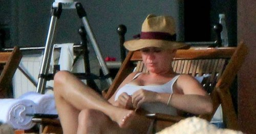 Katy Perry showcases stunning figure in belted swimsuit on Mexico beach