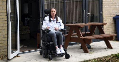 Disabled woman sleeping on mattress on floor due to broken equipment in home