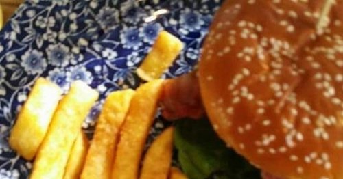 Fuming customer weighs his chips at Wetherspoon's table in portion size row
