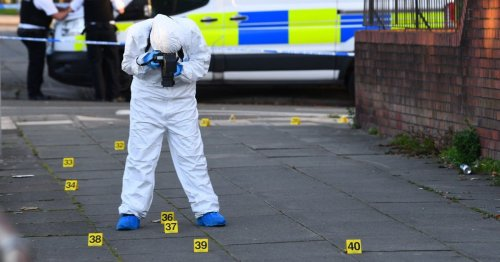 Man, 22, arrested on suspicion of murder after body found in alleyway