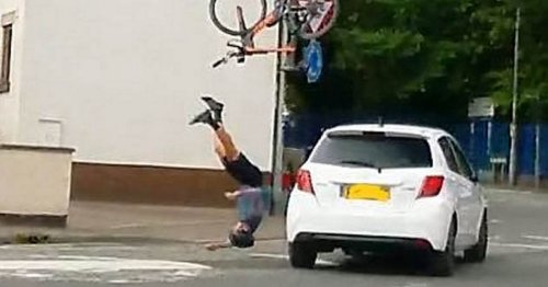 Incredible moment cyclist sent flying over car windscreen only breaks his toe