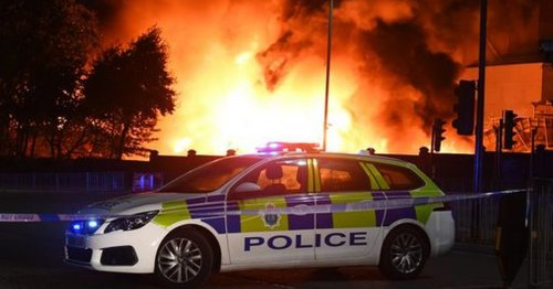 Massive fire erupts near docks with witnesses reporting explosions from the site