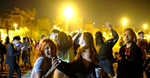 Spain marks end of Covid curfew with boozy street and beach parties