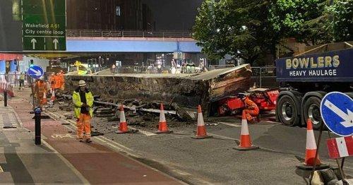 Huge 120-tonne bridge collapses from crane crushing truck on street