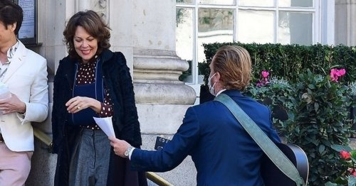 Helen McCrory laughs alongside Damian Lewis as they attended a friend's wedding