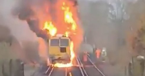 Early morning train catches fire sending black smoke into sky