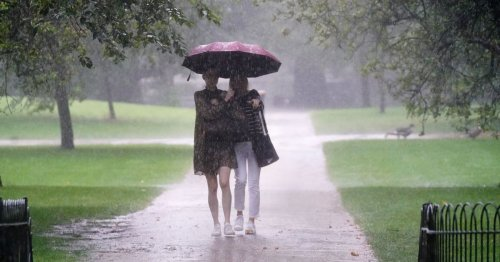 Torrential downpours with warning for heavy rain in UK after 23C heat ends