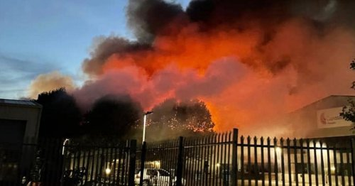Huge fire at building in town with locals told to close windows and doors