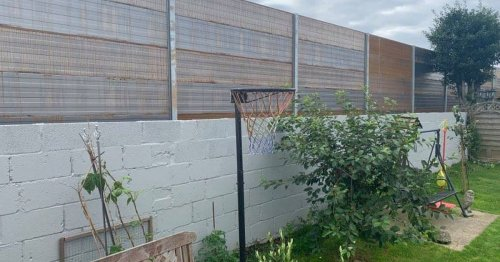 Furious residents blast 11ft fence that has made their homes feel 'like prison'