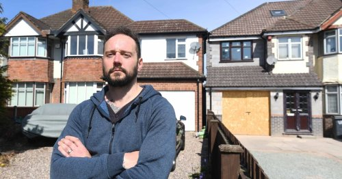Homeowner's anger after neighbour's extension comes within inches of property