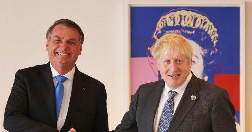 Boris Johnson tells Brazil's Bolsonaro to get Covid vaccine in awkward meeting